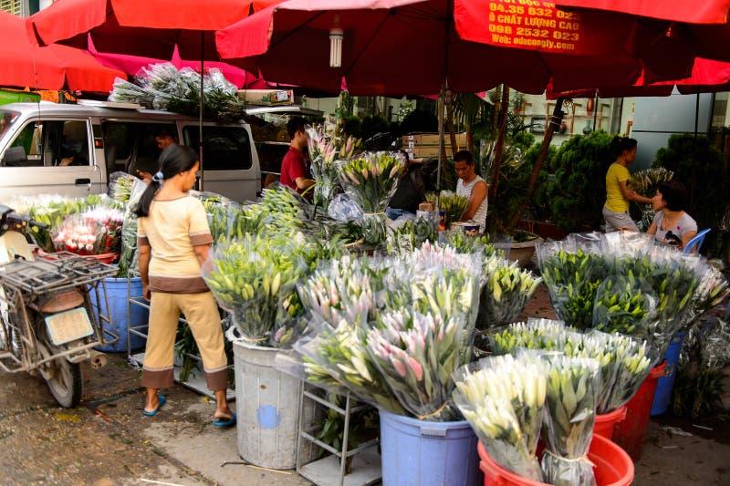 Flower market. HANOI, VIETNAM - SEP 23. 2014: Unidentified Vietnamese people work at the flower market in Hanoi, Vietnam. Flower market in Hanoi is one of the royalty free stock image