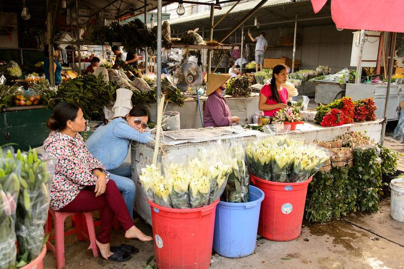 Flower market. HANOI, VIETNAM - SEP 23. 2014: Unidentified Vietnamese people work at the flower market in Hanoi, Vietnam. Flower market in Hanoi is one of the stock image