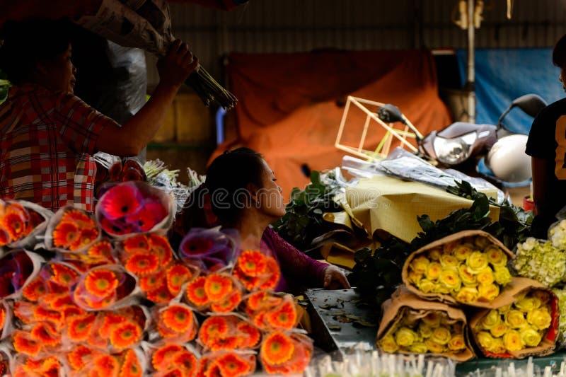 Flower market. HANOI, VIETNAM - SEP 23. 2014: Unidentified Vietnamese people work at the flower market in Hanoi, Vietnam. Flower market in Hanoi is one of the royalty free stock photo