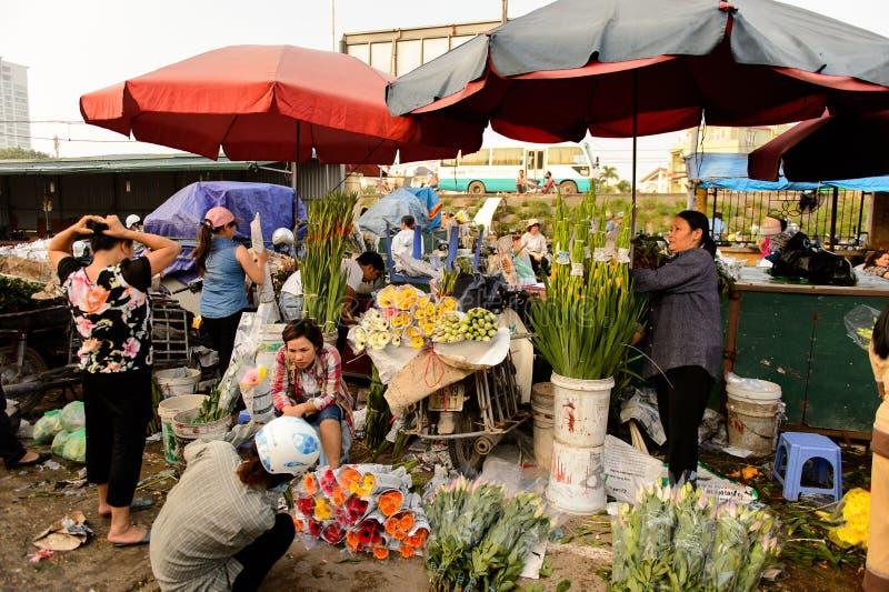 Flower market. HANOI, VIETNAM - SEP 23. 2014: Unidentified Vietnamese people work at the flower market in Hanoi, Vietnam. Flower market in Hanoi is one of the stock photo