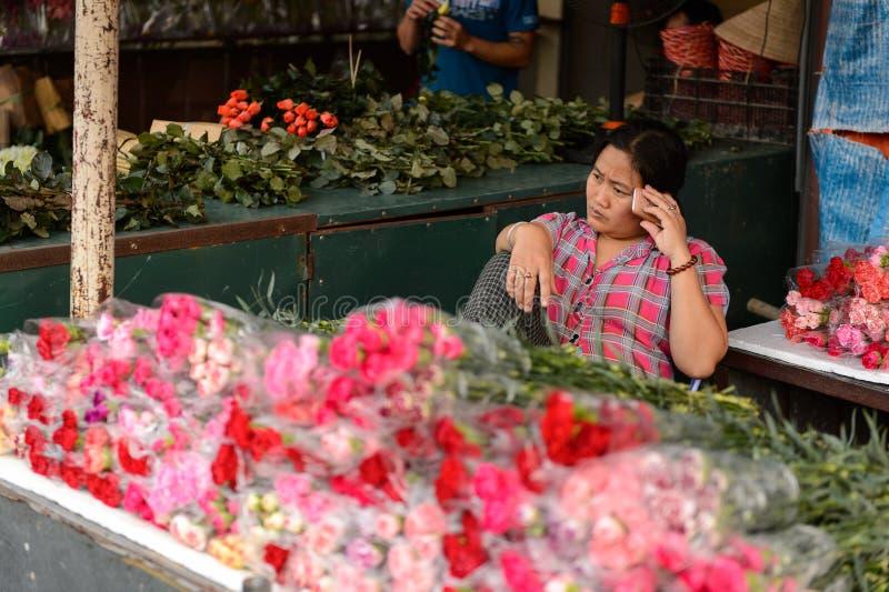 Flower market. HANOI, VIETNAM - SEP 23. 2014: Unidentified Vietnamese people work at the flower market in Hanoi, Vietnam. Flower market in Hanoi is one of the royalty free stock images