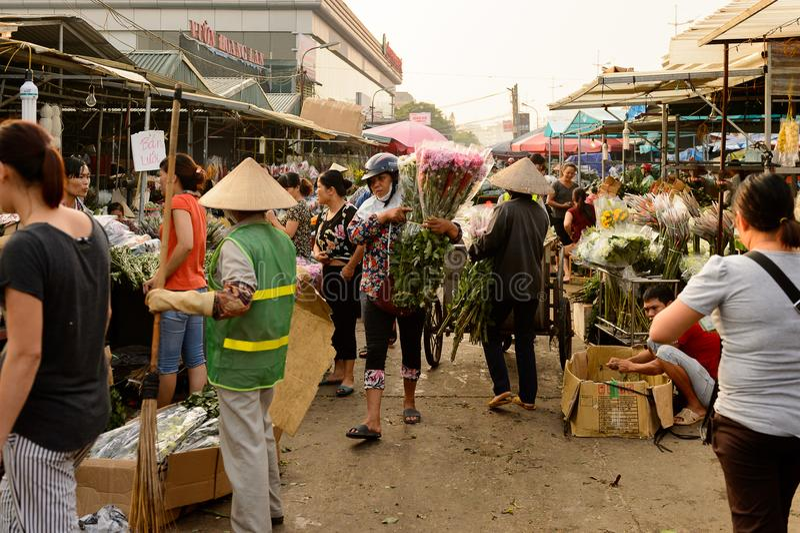 Flower market. HANOI, VIETNAM - SEP 23. 2014: Unidentified Vietnamese people work at the flower market in Hanoi, Vietnam. Flower market in Hanoi is one of the royalty free stock photos