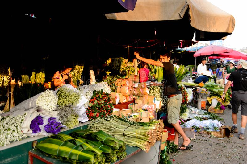 Flower market. HANOI, VIETNAM - SEP 23. 2014: Unidentified woman works at the flower market in Hanoi, Vietnam. Flower market in Hanoi is one of the largest stock image