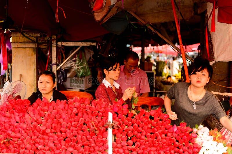 Flower market. HANOI, VIETNAM - SEP 23. 2014: Unidentified woman works at the flower market in Hanoi, Vietnam. Flower market in Hanoi is one of the largest stock photo