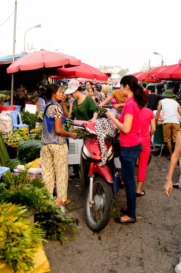 Flower market. HANOI, VIETNAM - SEP 23. 2014: Unidentified woman works at the flower market in Hanoi, Vietnam. Flower market in Hanoi is one of the largest royalty free stock photography