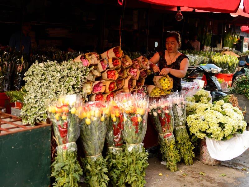Flower market. HANOI, VIETNAM - SEP 23. 2014: Unidentified woman works at the flower market in Hanoi, Vietnam. Flower market in Hanoi is one of the largest stock images