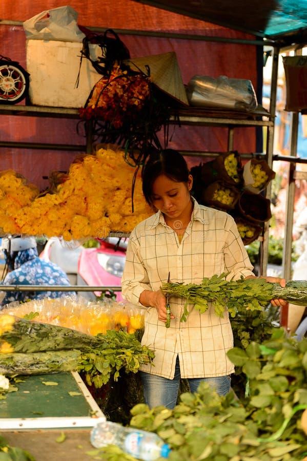 Flower market. HANOI, VIETNAM - SEP 23. 2014: Unidentified woman works at the flower market in Hanoi, Vietnam. Flower market in Hanoi is one of the largest stock photography