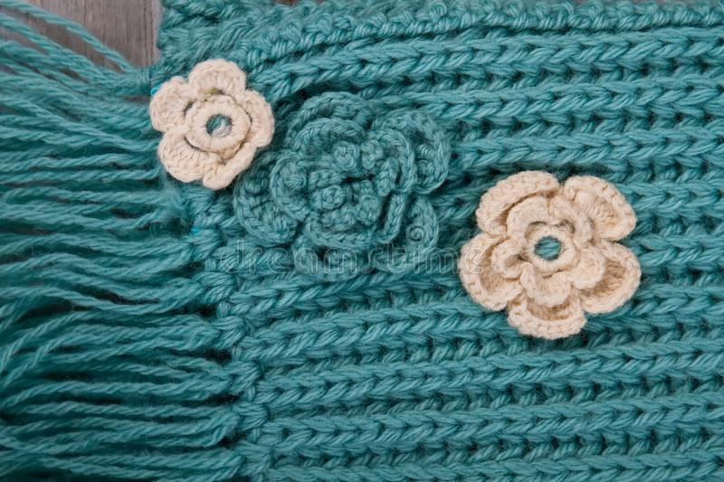 Flower ornaments on turquoise scarf royalty free stock photography