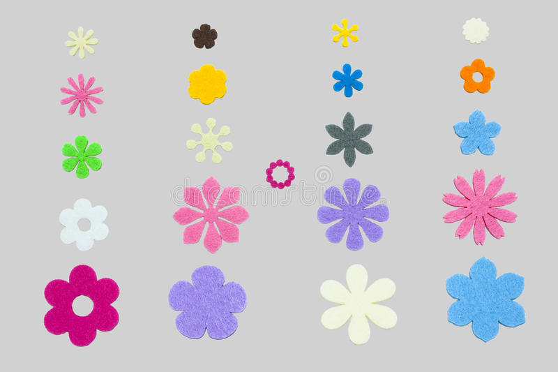 Flower Papercuts. Isolation Colorful Variety Shaped Of Flower Papercuts On Grey Background stock photography