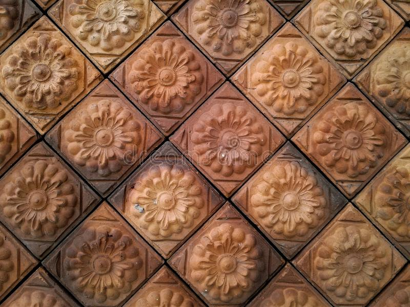 Flower pattern from brown bricks royalty free stock image