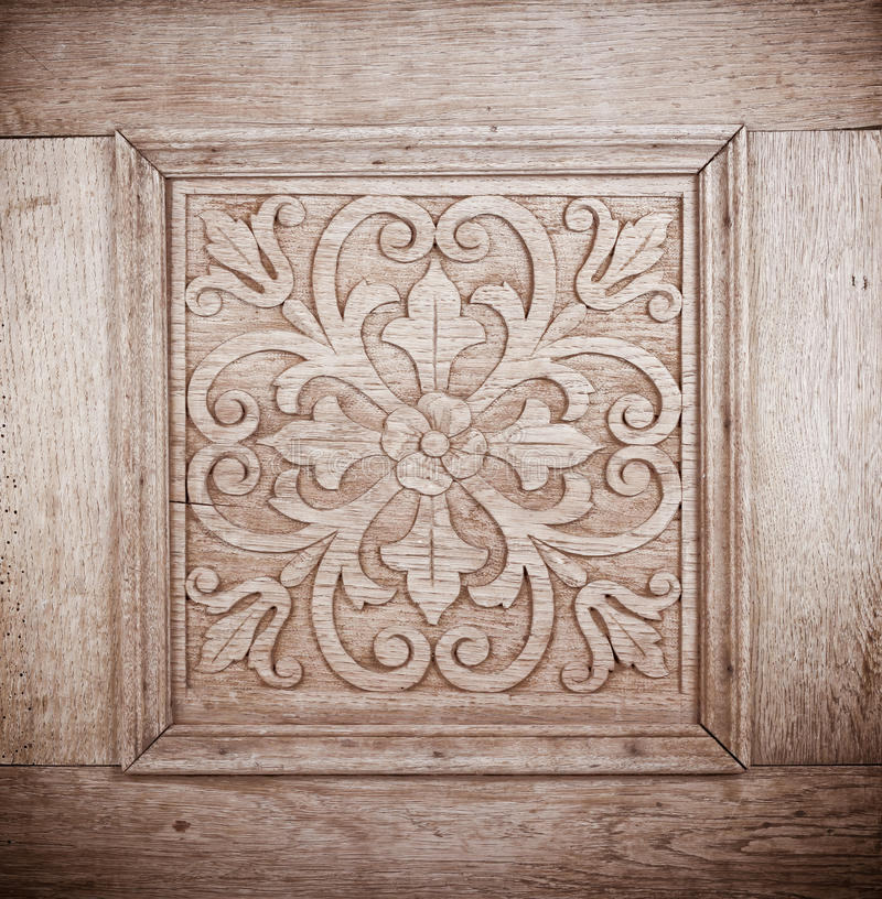 Flower pattern. Carved in wood royalty free stock photo