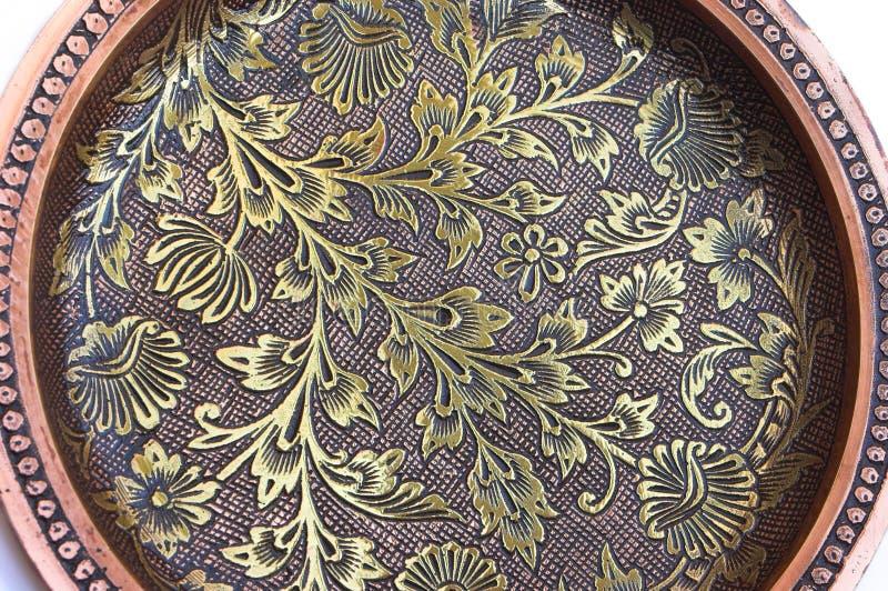 Flower pattern filigree work. Background of intricate flower pattern filigree (inlay) work on metal stock image