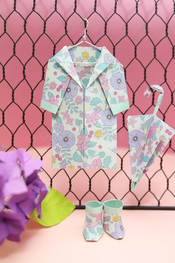 Flower pattern origami rain goods, raincoat, umbrella, boots stock images