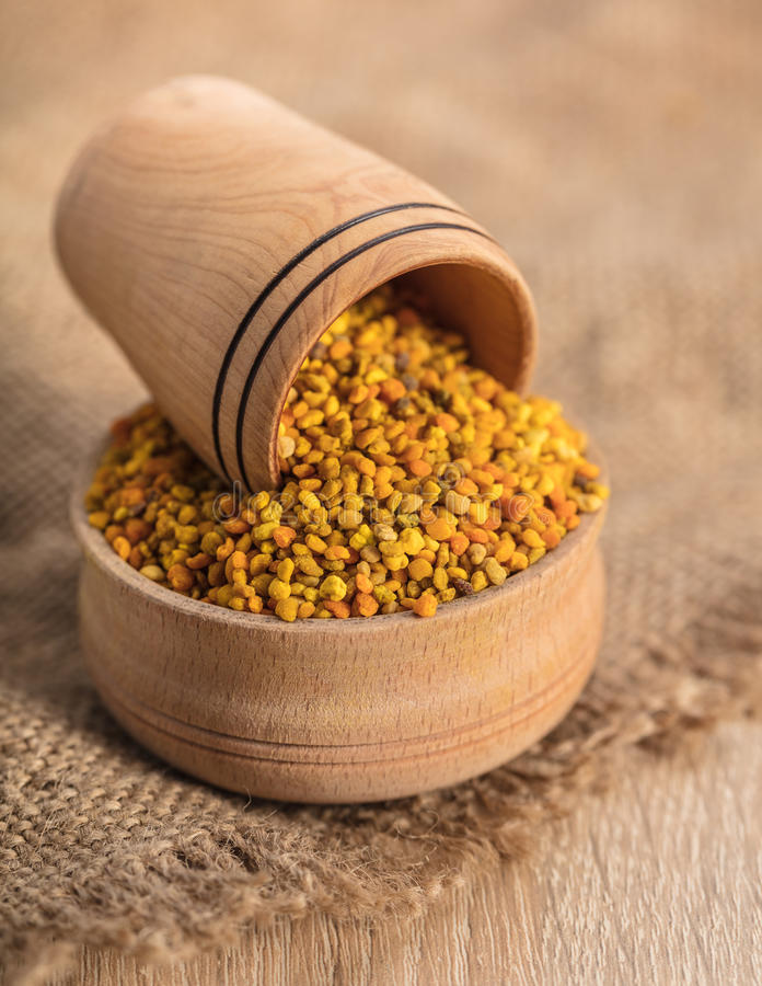 Flower pollen in a wooden bowl royalty free stock photo