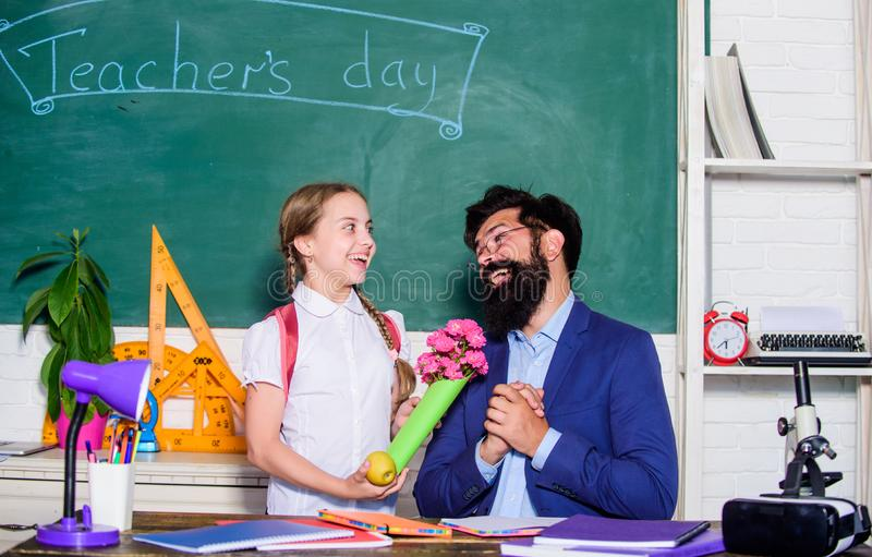 Flower present for best teacher. teachers day. Daugghter and father with flowers. back to school. Happy teachers day. Knowledge day is 1 september. small stock image