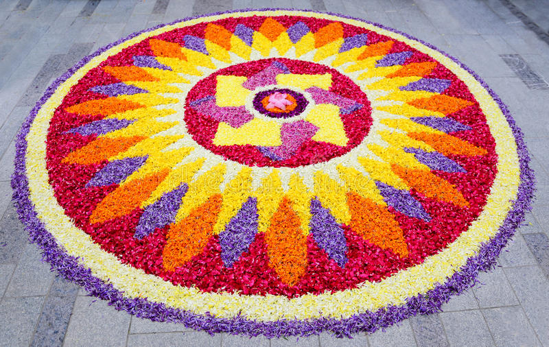 Flower rangoli. Rangoli is an art form native to Nepal India and Bangladesh in which patterns are created on the floor in living rooms or courtyards using stock photography