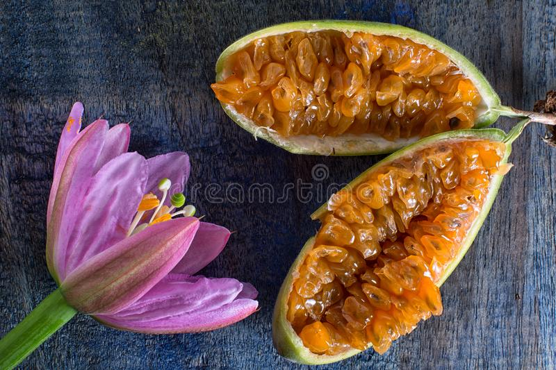 Flower and ripe cut passion fruit. Also known as taxo royalty free stock images