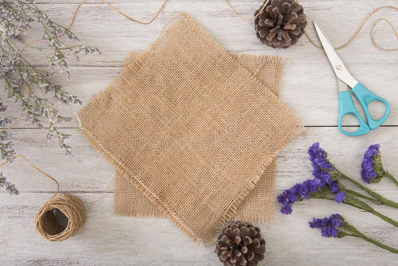Flower and sackcloth decoration on wood table with panel banner royalty free stock image