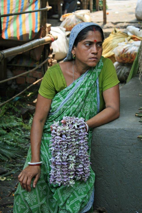 Flower Seller in Kolkata`s Flower Market royalty free stock image