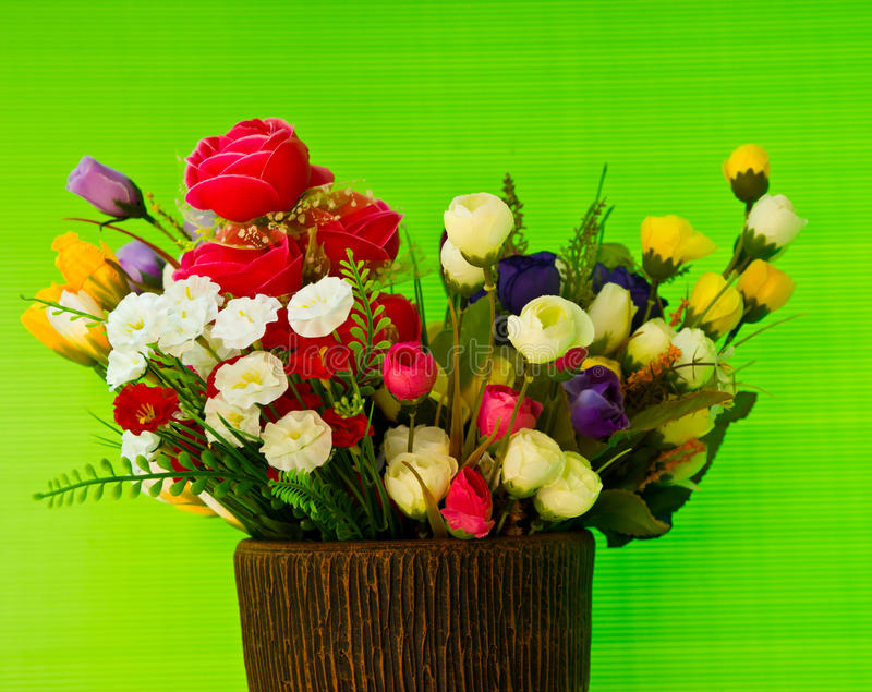 Flower sewing by hand on a green background. stock images