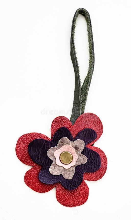 Flower shaped handmade leather keychain stock photos