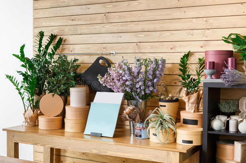 Flower shop interior, small business of floral design studio. Small business. Modern flower shop interior. Floral design studio, sale of decorations and royalty free stock image