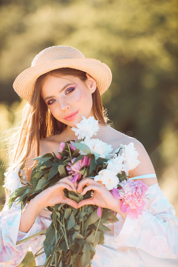 Flower shop. Natural beauty and spa therapy. Spring woman. Springtime and vacation. Summer girl with long hair. Woman. With fashion makeup. face and skincare royalty free stock photography