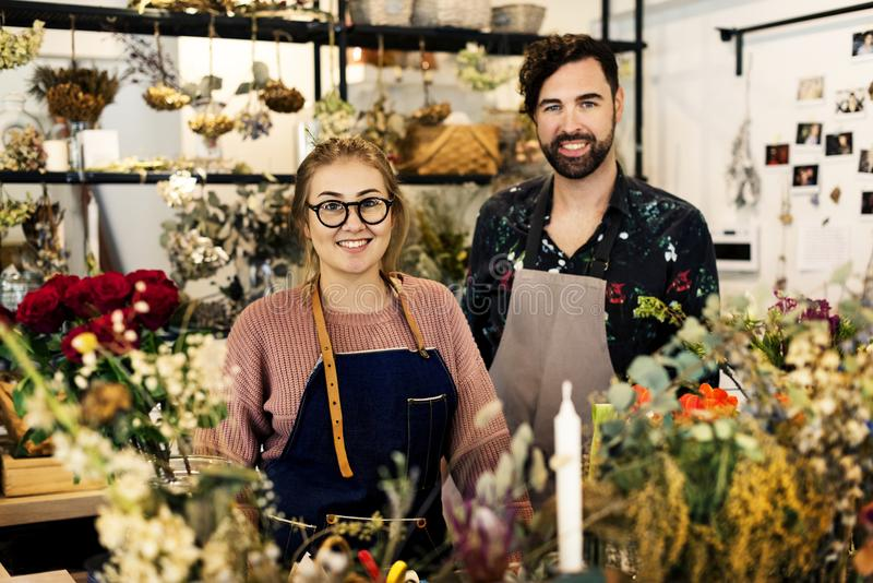 Flower shop small business owners royalty free stock photos