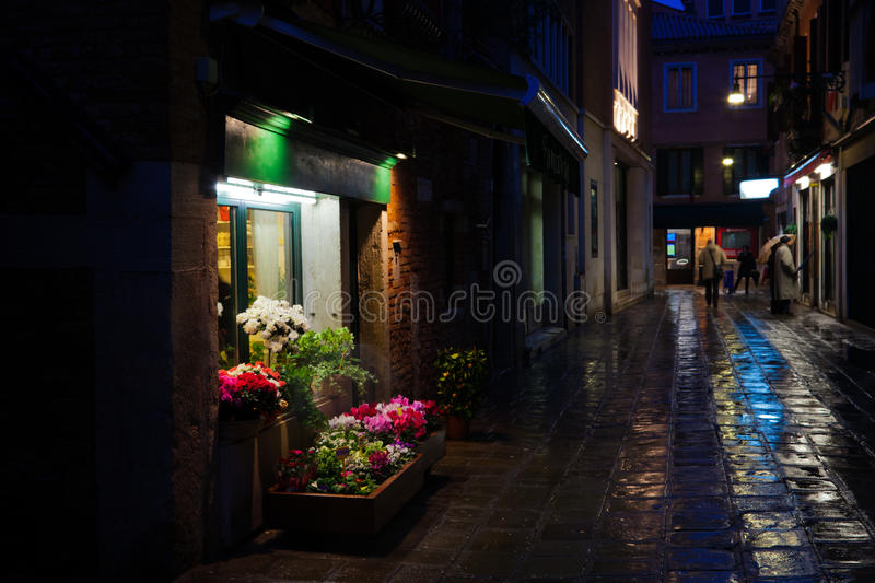 Flower shop in Venice at night. Flower shop in a small alley at night royalty free stock images