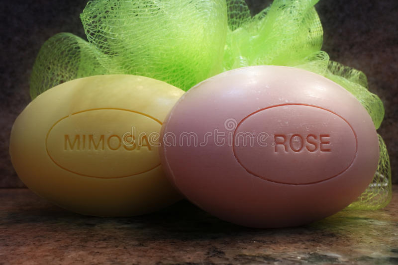 Flower soaps. Flower scented oval soaps skincare background royalty free stock images