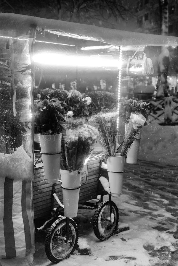 Flower stand at snowy night stock image