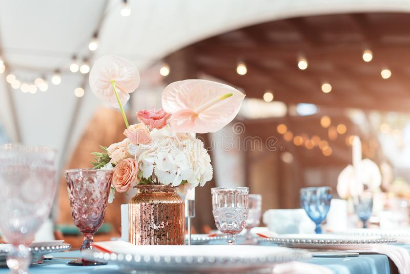 Flower table decorations for holidays and wedding dinner. Table set for holiday, event, party or wedding reception in. Outdoor restaurant royalty free stock photography