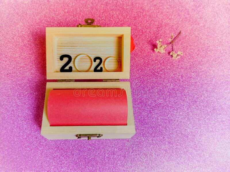 inspirational number of 2020 in small wooden treasure box in vintage background royalty free stock image