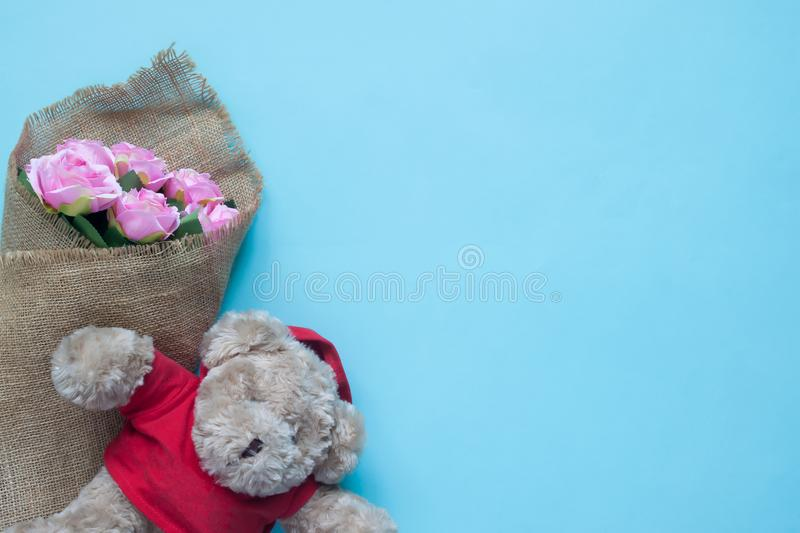 Flower and teddybear on blue background, Special day concept royalty free stock photo