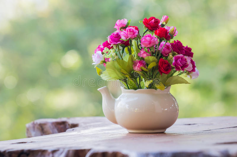 Flower in vase with green bokeh stock photo