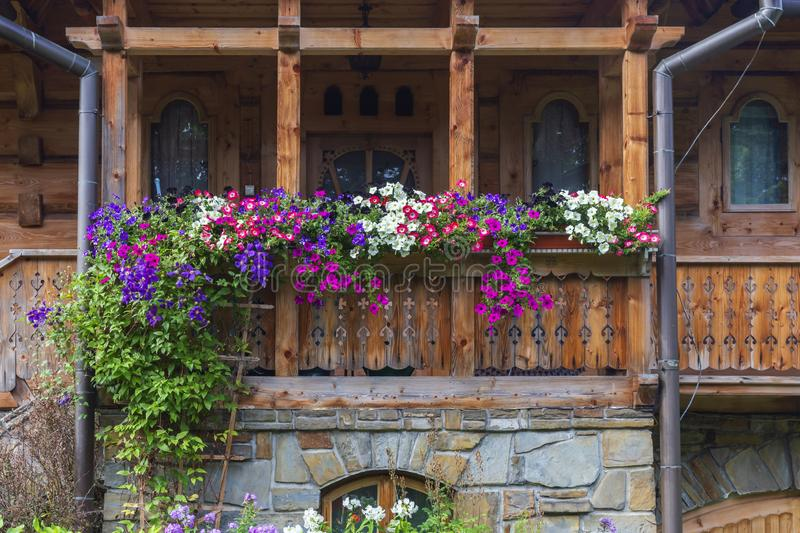 Flowerbeds on the balcony of a wooden house. Nature royalty free stock image
