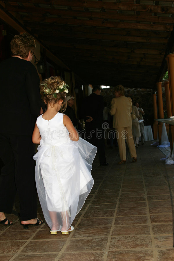 Flowergirl. Flower girl waiting for bride royalty free stock image