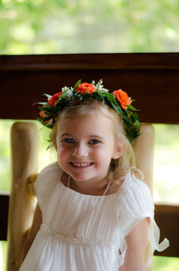 Flowergirl. A cute flower girl preparing for wedding royalty free stock photography