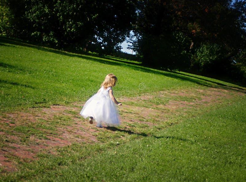 Flowergirl. A flower girl running away stock images