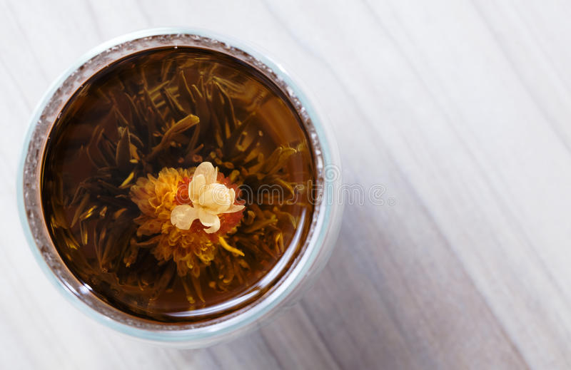 Flowering Tea and Dry Flowers on Wooden Background royalty free stock images