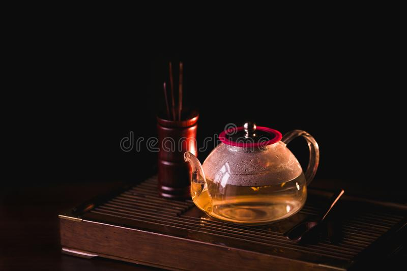 Flowering tea in teapot on a tea desk chaban. Blooming Tea. Flowering tea in teapot on a tea desk chaban royalty free stock image
