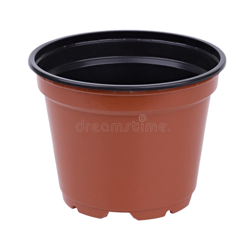 Flowerpot. Brown plastic flowerpot kashpo plant pot royalty free stock photos