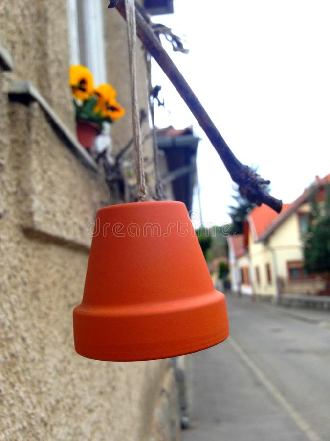 Flowerpot ornament. An ornament made of flowerpot hanging from a window royalty free stock photo