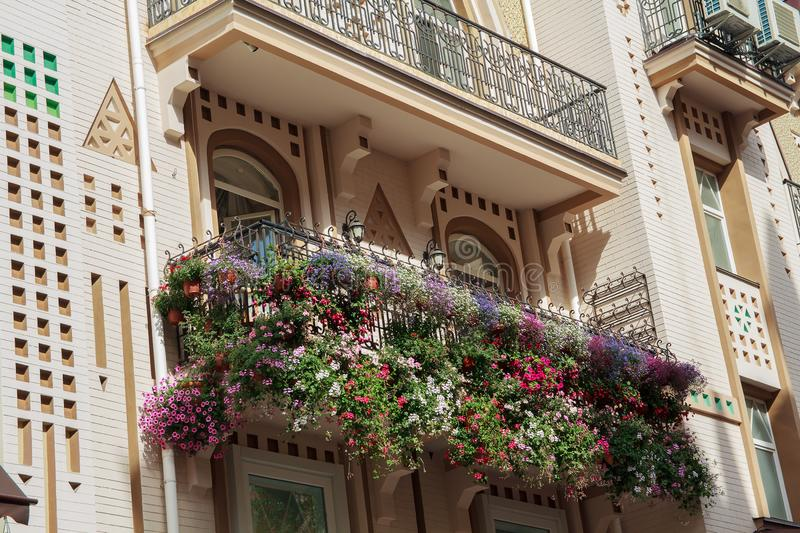 Flowers on the balcony of a luxury house in a classic style stock image
