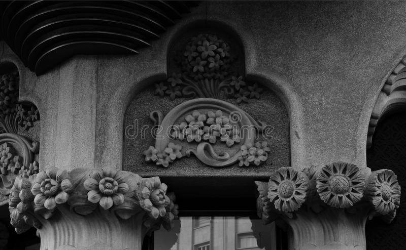 Flowers are beautiful. Shot in black and white, detail on an sculpture representing some flowers placed on the facade of this historic building Lleo Morera , set royalty free stock photography