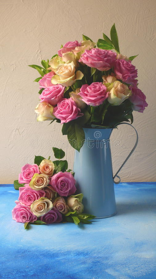 Flowers in a blue vase stock images
