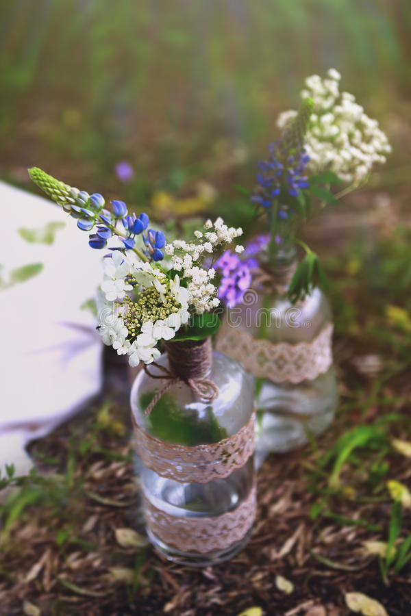 Flowers In The Bottles In The Forest royalty free stock photos