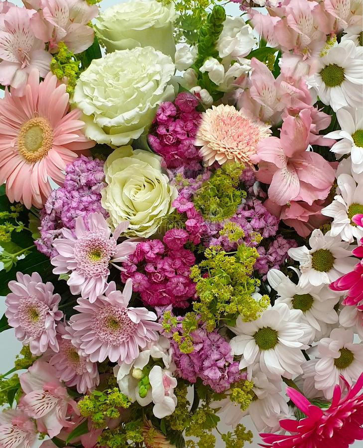 Flowers bouquet flavor flavour colorful red pink yellow green lilac floral background for greeting card wedding woman day or valen. Beautiful Flowers bouquet stock photography