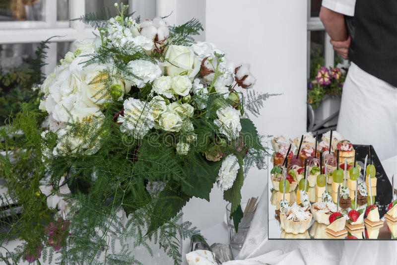 Download Flowers Bouquet And Tray Canapes Stock Image - Image of catering, glass: 26615015