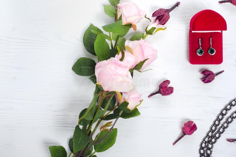 Flowers box with earrings handbag royalty free stock photography